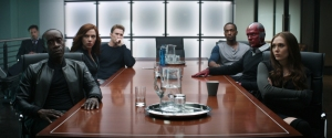 """In this image released by Disney,Don Cheadle, seated at table from left, from Scarlett Johansson, Chris Evans, Anthony Mackie, Paul Bettany and Elizabeth Olsen appear in a scene from """"Captain America: Civil War."""" (Disney-Marvel via AP) ORG XMIT: NYET129"""